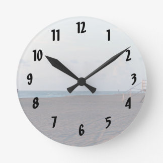 lifeguard shack on beach with walker wall clocks