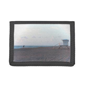 lifeguard shack on beach with walker wallet