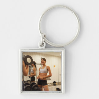 Lifting weights in the gym keychains