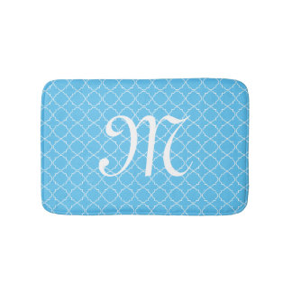 Light blue monogram quatrefoil pattern bath mat
