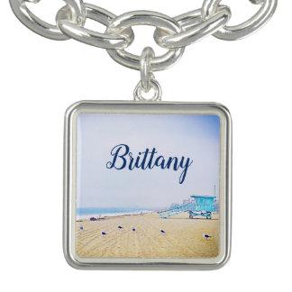 Light blue sky and sandy beach photo custom name