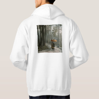 Light Breaks Through as Monk Descends Temple Steps Hoodie