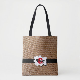 Light brown straw monograms bag. tote bag
