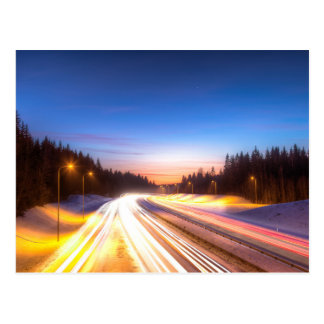 Light rays of cars on a highway postcard
