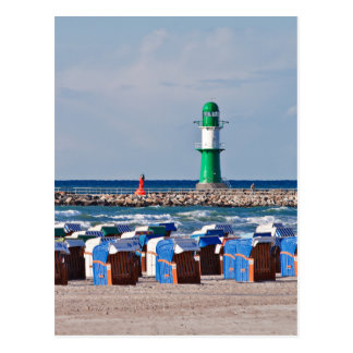 Lighthouse and beach chairs in Warnemuende Postcard