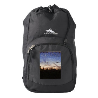 Lighthouse at sunset backpack
