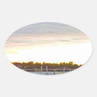Lighthouse at Sunset Oval Sticker