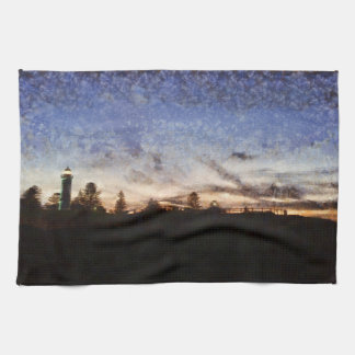 Lighthouse at sunset tea towel