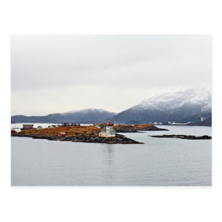Lighthouse on island in Norwegian fjord Postcard