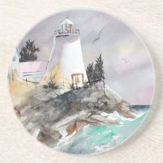 Lighthouse on rocky shore coaster