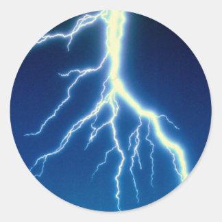 Lightning bolt over blue background round sticker