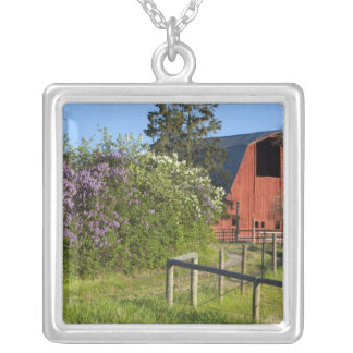 Lilac bushes in bloom and magpies in the trees square pendant necklace