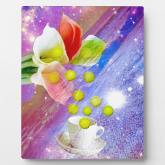 Lilies drop tennis balls to celebrate . plaque