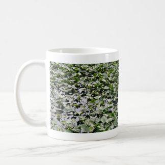 Lilly pads on a pond coffee mug