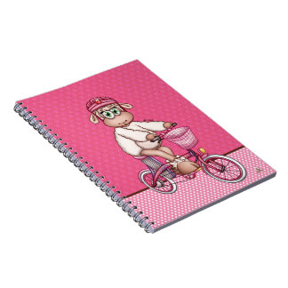 Lilly The Sheep riding an electric bicycle Notebook