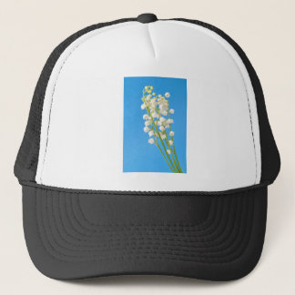 lily of the valley trucker hat