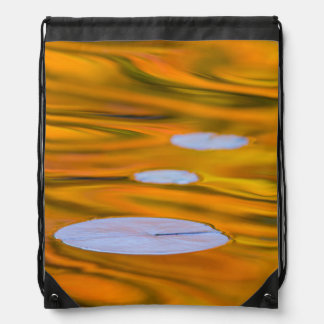 Lily pad on orange water, Canada Drawstring Bag