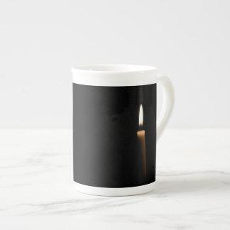Lit candle bone china mug