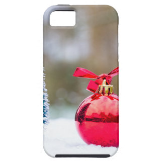 Little christmas tree and red bauble in snow iPhone 5 covers