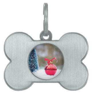 Little christmas tree and red bauble in snow pet name tag