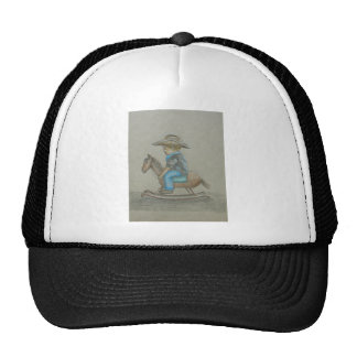 little cowboy riding on toy horse hat