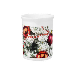 Little decorated christmas tree with baubles pitcher