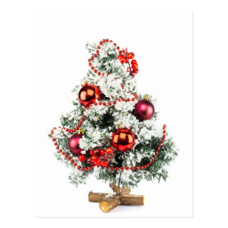 Little decorated christmas tree with baubles postcard