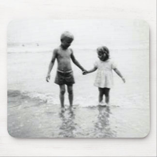 Little girl and boy holding hands mousepad