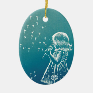 Little girl blowing on a dandelion ceramic ornament
