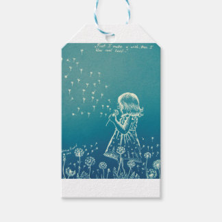 Little girl blowing on a dandelion gift tags