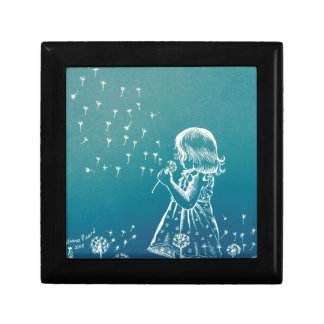 Little girl blowing on a dandelion small square gift box