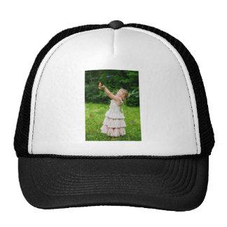 Little Girl Catching a Butterly Cap