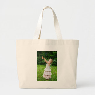 Little Girl Catching a Butterly Large Tote Bag