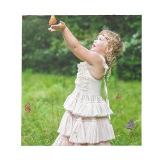 Little Girl Catching a Butterly Notepad
