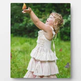 Little Girl Catching a Butterly Plaque