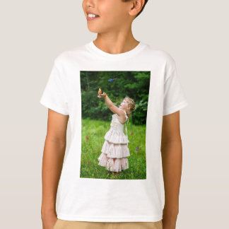 Little Girl Catching a Butterly T-Shirt
