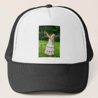 Little Girl Catching a Butterly Trucker Hat