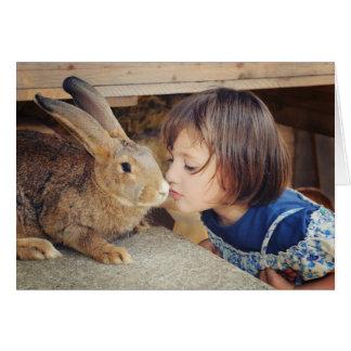 Little girl kissing a rabbit card