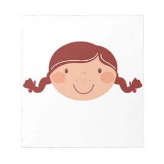 Little girl on white notepad