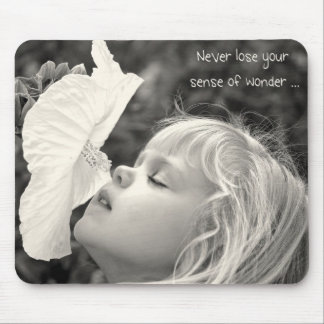Little girl smelling hibiscus mouse pad
