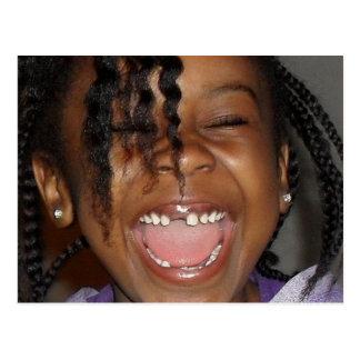 Little girl smiling hard missing teeth postcard