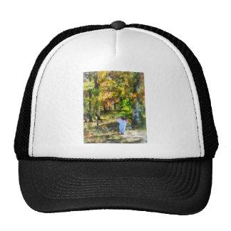 Little Girl Walking in Autumn Woods Hat