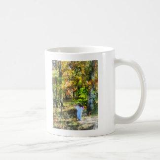 Little Girl Walking in Autumn Woods Mugs