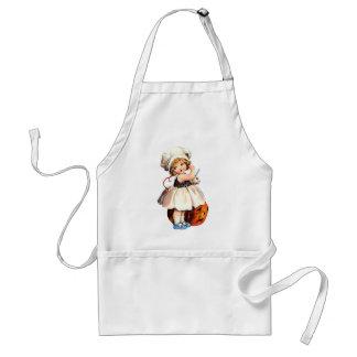 little girl with pumpkin apron
