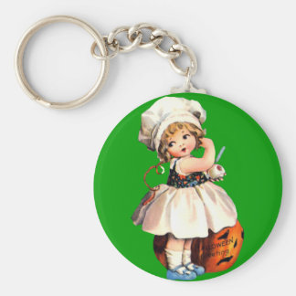 little girl with pumpkin key chains