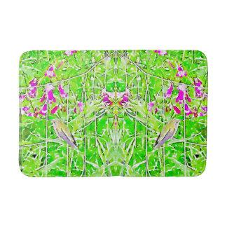 Little green hummingbird  and purple flowers bath mat