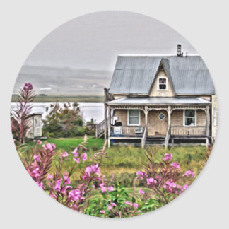 Little house with a field of flowers round sticker