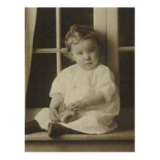 Little kid holding stuffed toy postcard