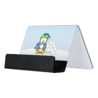 Little penguin sitting with snowballs desk business card holder