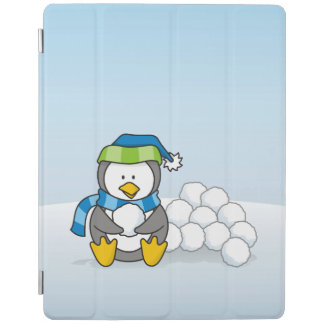 Little penguin sitting with snowballs iPad cover